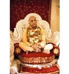 Srila Prabhupada on Cream Colored Vyasanasna with Many Flower Garlands