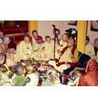 Prabhupada Sitting Around Fire Yajna Chanting on Devotees Beads
