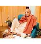Srila Prabhupada Sitting Relaxed on Blue Seat